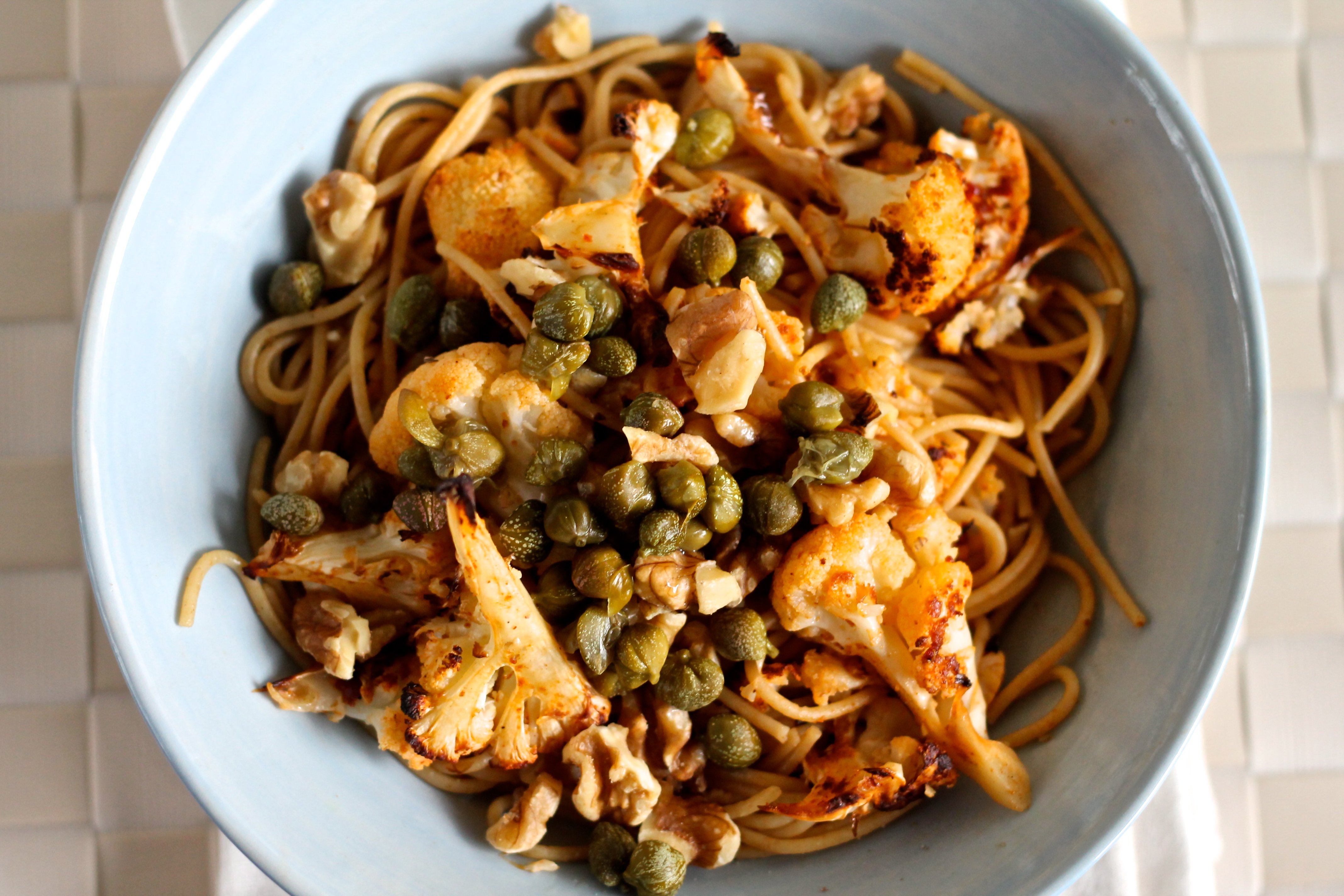 whole wheat spaghettini with harissa roasted cauliflower, capers, and walnuts